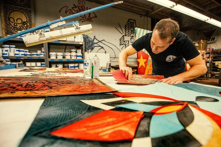 Shepard Fairey working in his studio