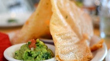 Chicharron de queso with guacamole and salsa verde cruda at Loteria Grill